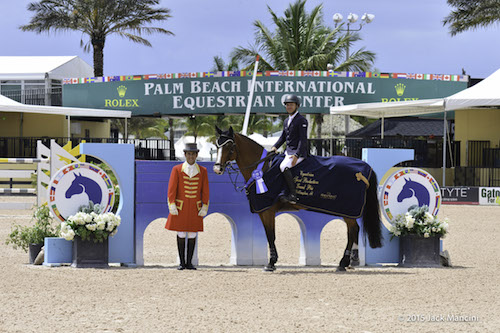 Kent Farrington and Belle Fleur 38 in their winning presentation with ringmaster Gustavo Murcia © Mancini Photos