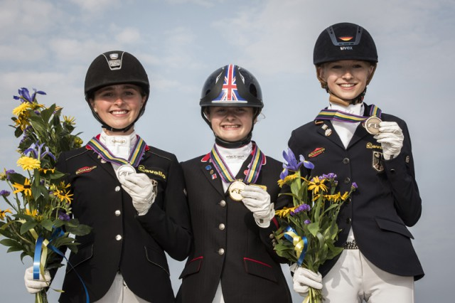 On the podium for the individual Dressage Championship at the FEI European Pony Championships 2015 in Malmo, Sweden: (L to R) silver medallist Nadine Krause (GER), gold medallist Phoebe Peters (GBR) and bronze medallist Helen Erbe (GER). © FEI/LottaPictures AB