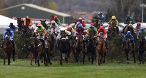 Riders compete in The Grand National Steeple Chase on the final day of the Grand National Festival horse race meeting at Aintree Racecourse in Liverpool, northern England on April 9, 2016. The annual three day meeting culminates in the Grand National which is run over a distance of four miles and four furlongs (7,242 metres), and is the biggest betting race in the United Kingdom. / AFP PHOTO / OLI SCARFF