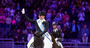 Isabell Werth (GER) celebrates victory with Weihegold Old in today's FEI World Cup™Dressage Final Grand Prix in Omaha (USA). © Cara Grimshaw/FEI