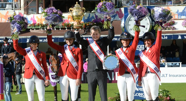 The US team of Laura Kraut, Lillie Keenan, Lauren Hough and Beezie Madden with Chef d'Equipe Robert Ridland hold the Aga Khan Trophy aloft after winning the eighth and final leg of the FEI Nations Cup™ Jumping 2017 Europe Division 1 League in Dublin (IRL). © FEI / Christophe Taniere